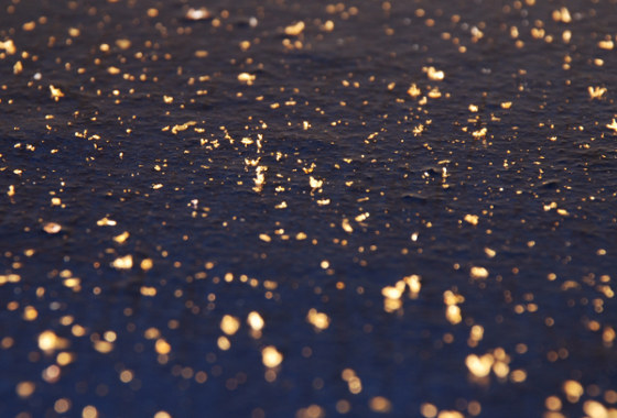 Gold sprinkle on indigo paper   photograph by KT Kacur