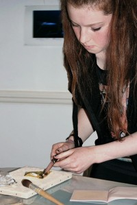 Julia preparing a square of gold leaf