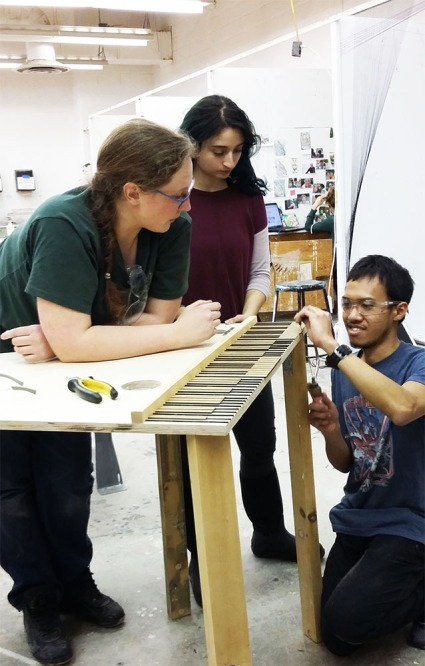Sophia, Yomna and Reza attaching the laser-cut piano-keys